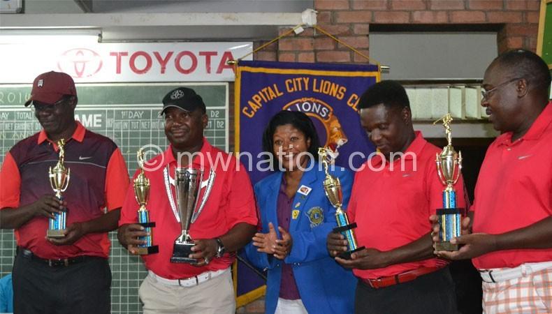 The MDF team that won the tournament pose with Lion Gunda (C)