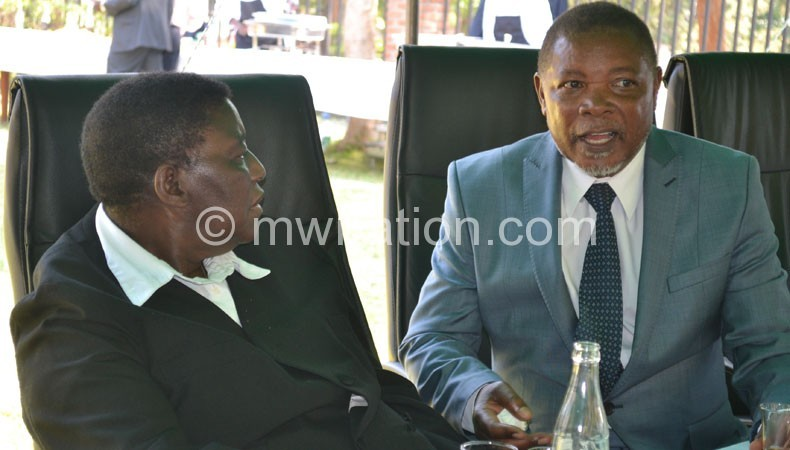 Msosa (L) and Munlo sharing notes on the sidelines of the party