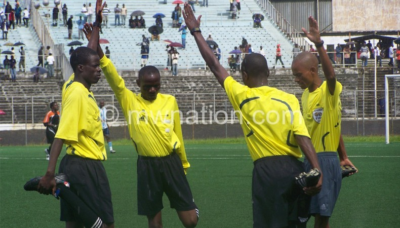 Raphael (R) and other referees warm up ahead of a local match