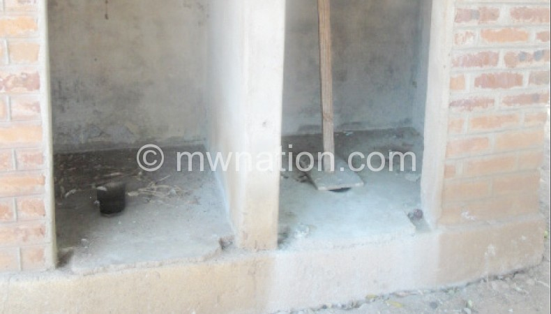 The full latrines being used to dump the placentas