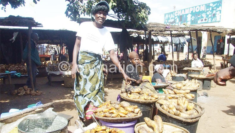 Nyama selling boiled potatoes  at Mponela Trading Centre