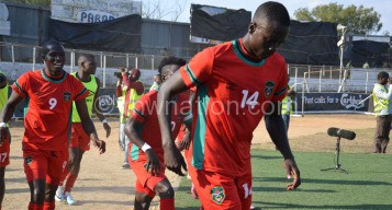 It's still a tall order: Limbikani Mzava (No. 14) seems to think after celebrating a goal at Kamuzu Stadium