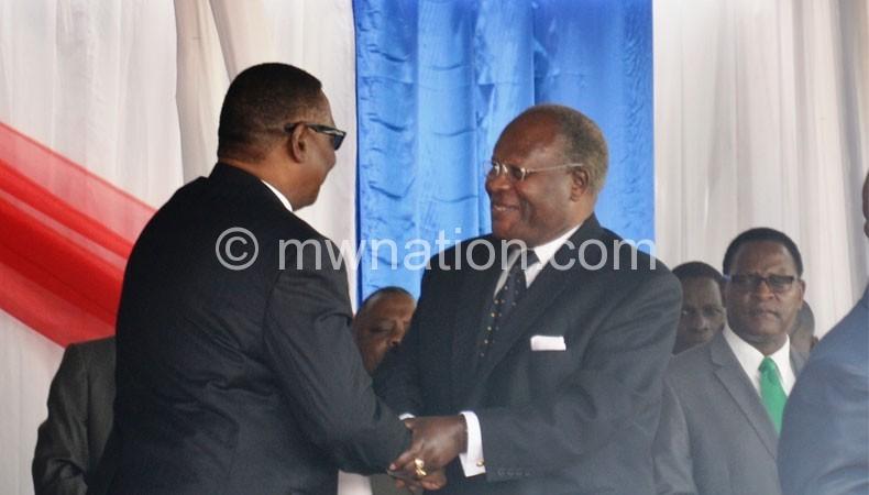 Mutharika greeted Muluzi (C) but snubbed Chakwera (R)