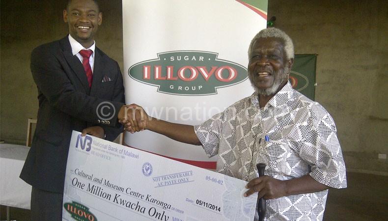 Nyamilandu (L) hands over the cheque to Mwakasungula