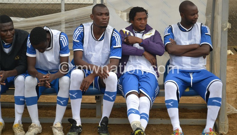 Some of Wanderers' players warm the bench during a recent game