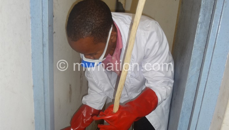 Chalamanda cleans one of the toilets