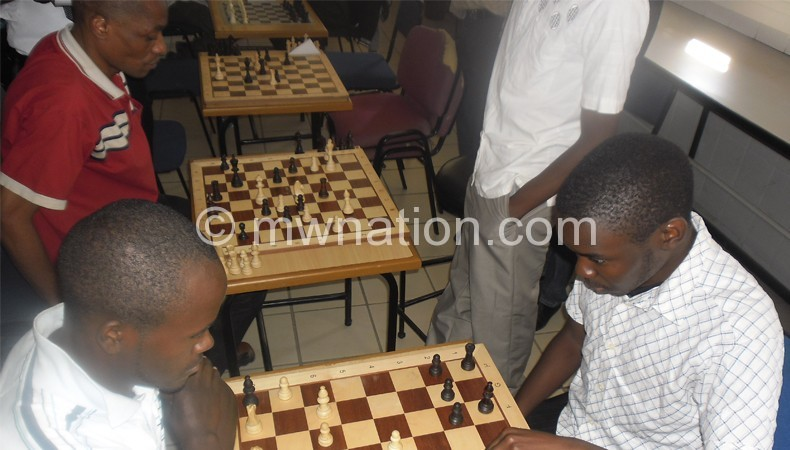 Chess players in action