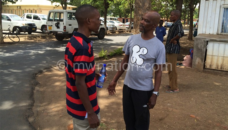 Ray Phiri (R) share some notes with local musician Lawi