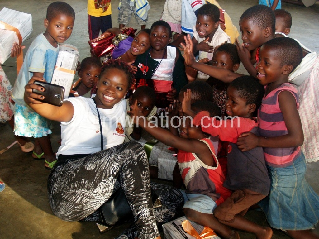 Blantyre Rotaracts member enjoys the moment with kids