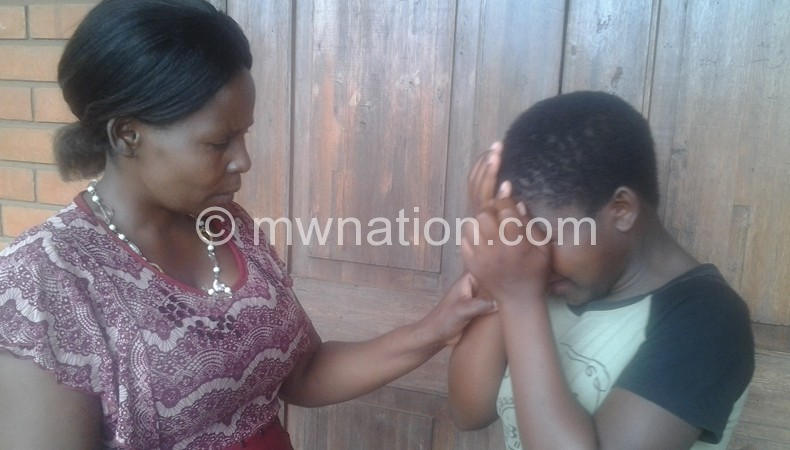 Gertrude (R) breaksdown as she shares her story to Mfulusa