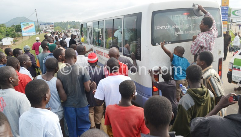 Welcome back home: Blantyre Bullets fans mob the bus carrying the team as it crawled into the team's home city