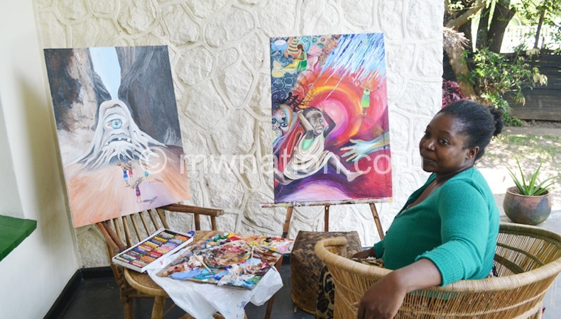 Chikabadwa with her paintings at the symposium