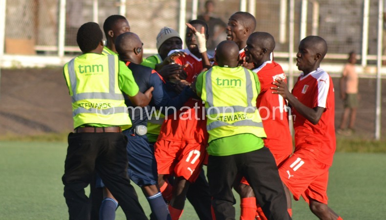 Red Lions players physically confronting Kapinga