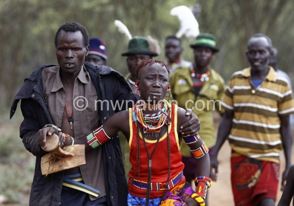 A young girl being taken  to her husband in East Africa where arranged marriages are common