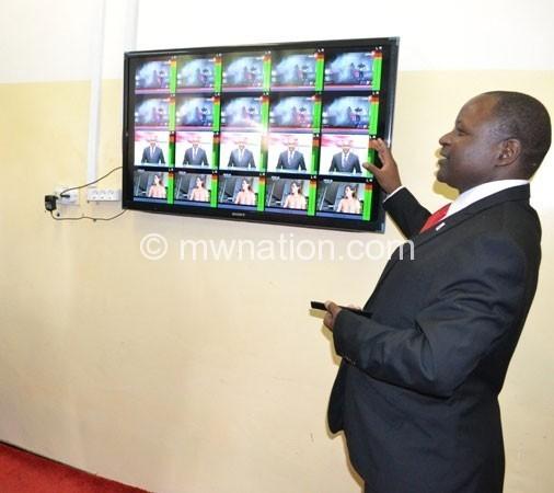Chirwa demonstrating how the digital migration stystem will work