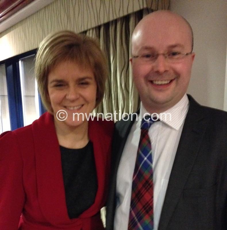 Grady standing next to Nicola Sturgeon, the First Minister of Scotland