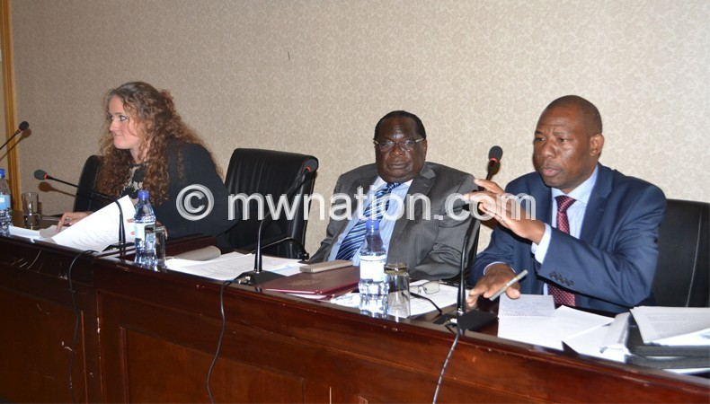 Secretary to the Treasury Ronald Mangani (R) addressing the meeting as Gondwe (C)  and Marshall listen