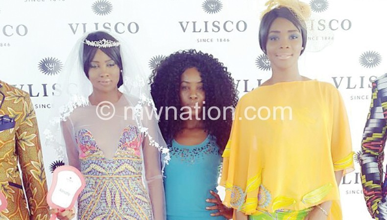 Misomali (C) with models who showcased her designs at the event