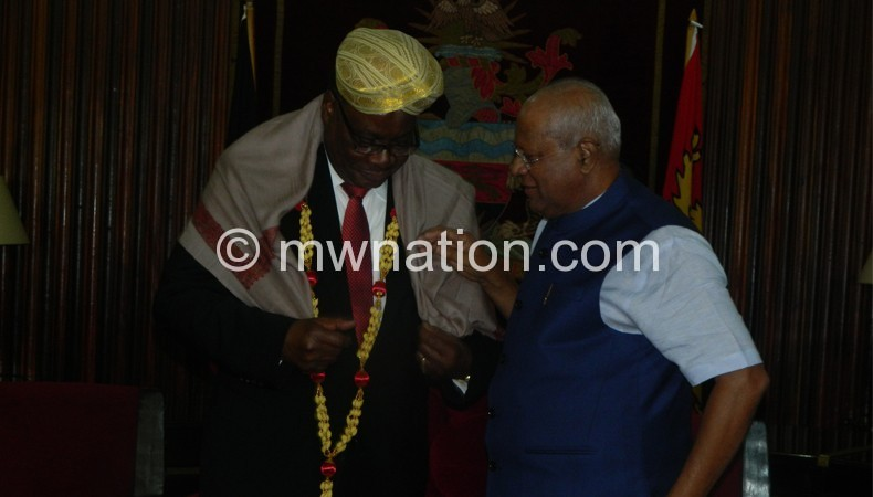 Mutharika fitting Indian traditional wear supervised by Siddeshwara