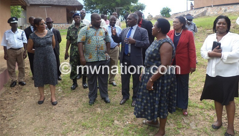Minister of Information, Tourism and Culture Kondwani Nankhumwa being conducted on a tour of Mpale Cultural Village in Mangochi