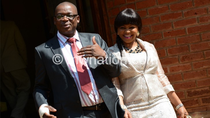 Struck off: Kalonga (L) with a  well-wisher during an earlier  court appearance