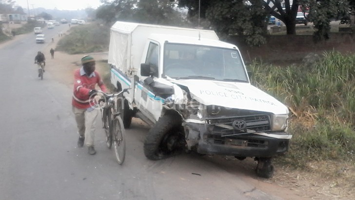 Police vehicle in road mishap