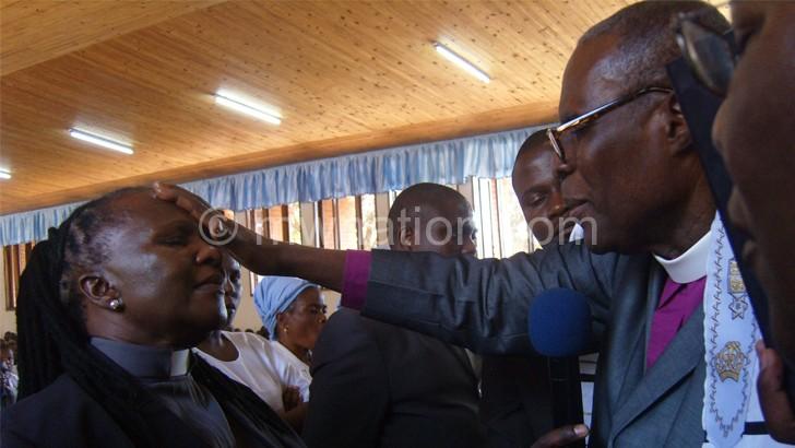 Bishop Ansah (R) ordains Ndlovu as CIC pastor