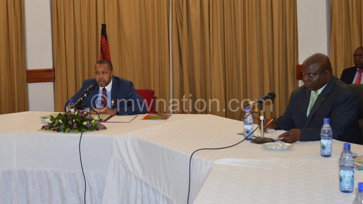 Chilima giving the progress report on the reforms last week as PS for Information, Tourism and Civic Education Justin Saidi looks on
