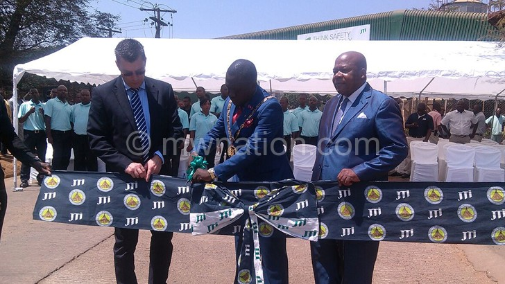 Deputy Mayor Kwame Bandawe cutting a ribbon to mark the opening of the road