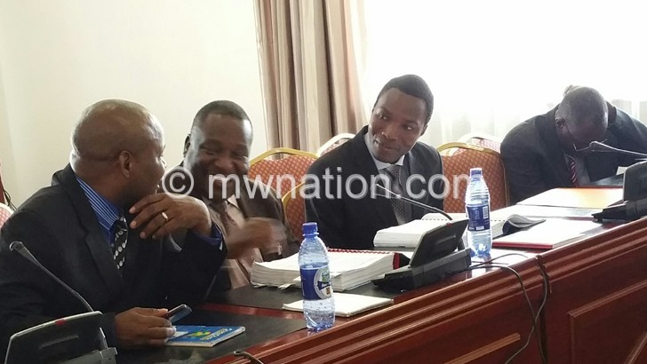 Sharing a lighter moment: Thombozi (C) and Mandere (L) at the meeting yesterday