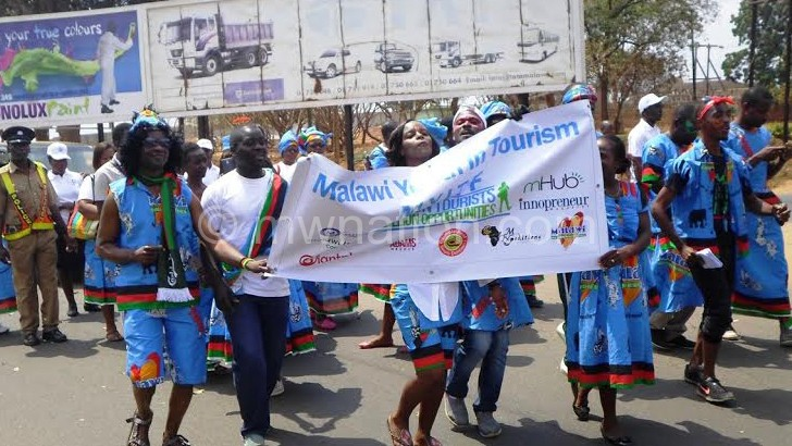 Officials from the public and private sector marching during the street carnival
