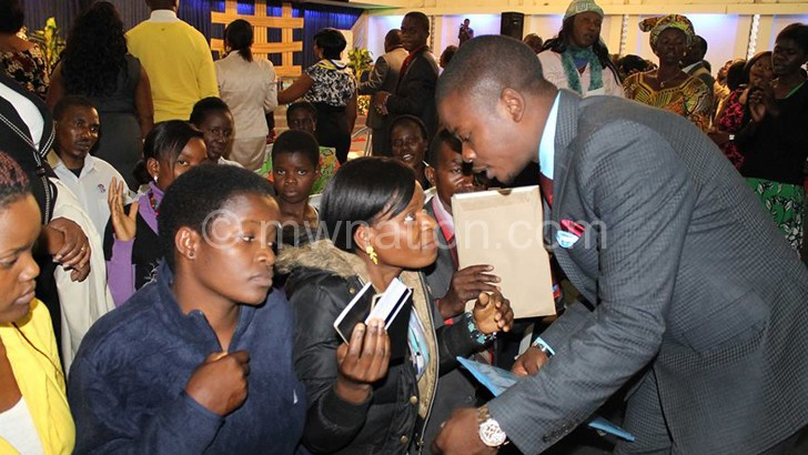 Bushiri (R) interacts with some of his believers