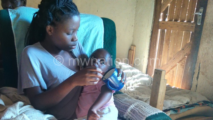 Faith being fed by her mother after the accident