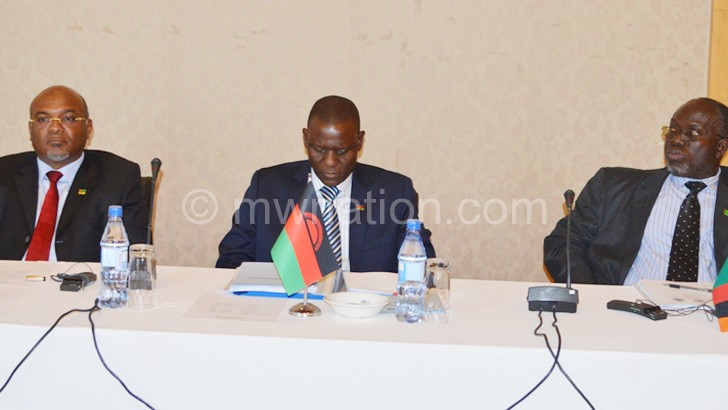 How do we move forward?: Mesquita (L), Kasaila (C) and Mwale in the thick of things