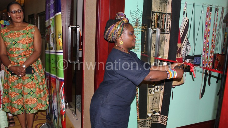 Mashanda cuts the ribbon to officially launch the gallery