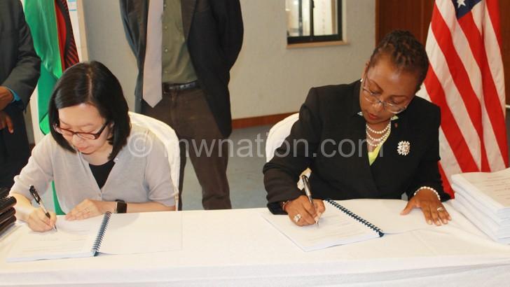 Banda (R) and Wu sealing the deal last week