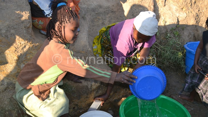 huge selection of 9c11e 4ab8e Rural women are seen drawing water from an unsafe water source