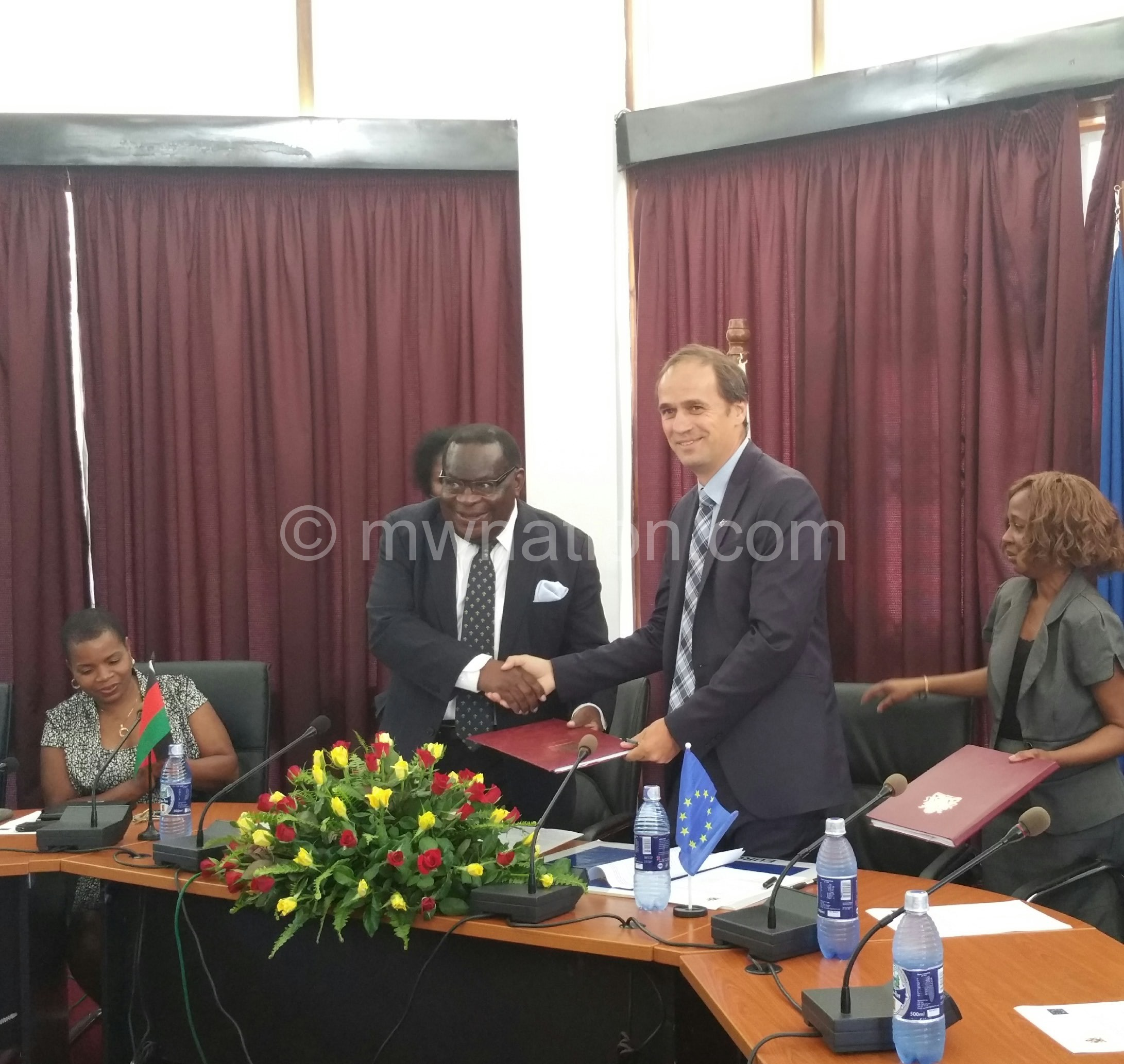 EU head of delegation to Malawi Marchel Gerrmann (R) and Minister of Finance Goodall Gondwe (L) exchanging signed agreements