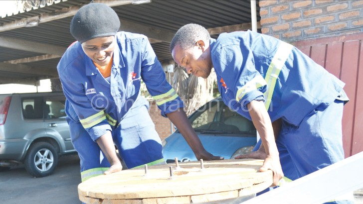 Assisted by a colleague, Beatrice gauges how best to get a job done