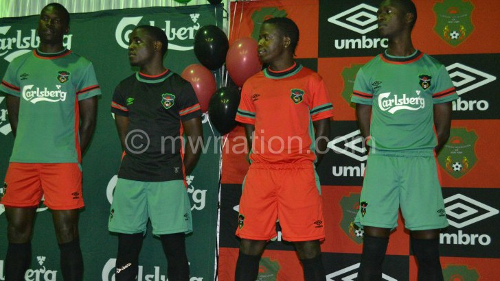 Flames players showcasing Umbro replicas during the launch last year