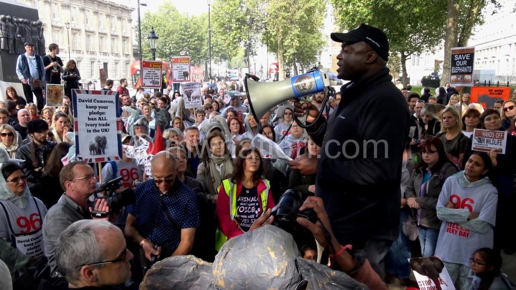 Musyani addressing marchers in London