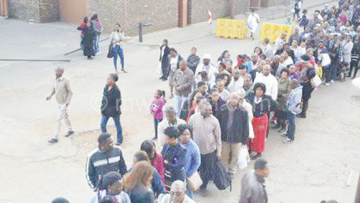 eople queue for an audience with Bushiri in South Africa