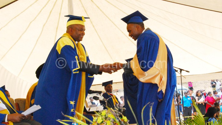 Mtumbuka (L) congratulates one of the graduands