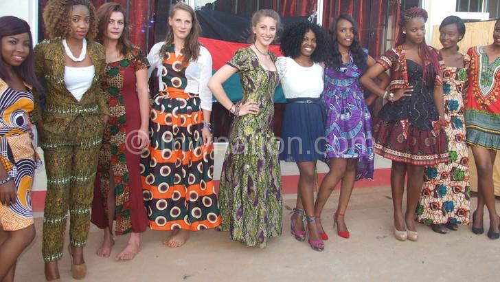 Models exhibiting chitenje-centric designs at a Mzuzu fashion event, and (below)  videographer Chipi Khonje dons a chitenje inspired shirt
