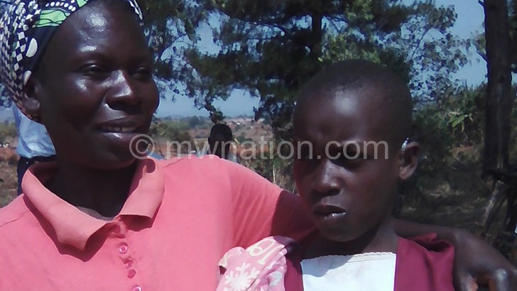Theu (L) and her daughter Dora are now living a better life