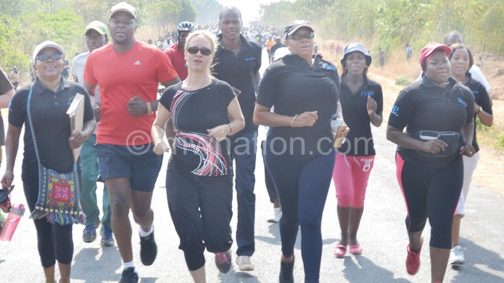 Running for charity: Seppo and Banda lead the pack in Mchinji on Saturday