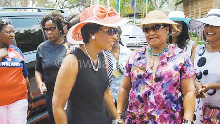 The First Lady (in red hat) being welcomed on arrival by Kaliati