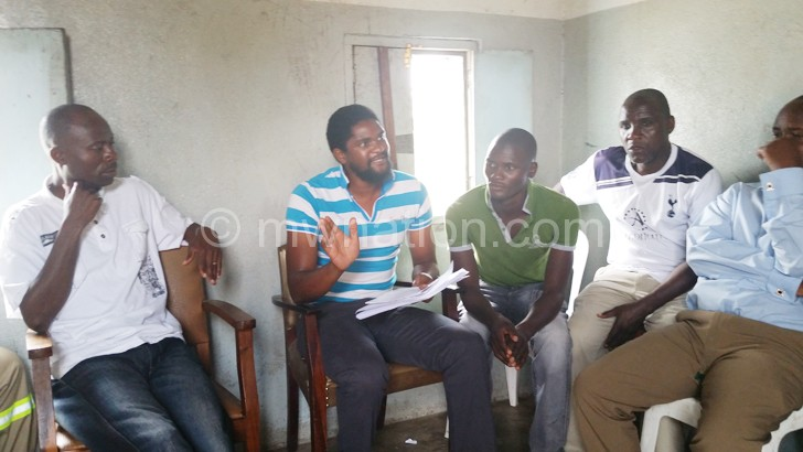 Gobede (2ndL) making his point during the meeting