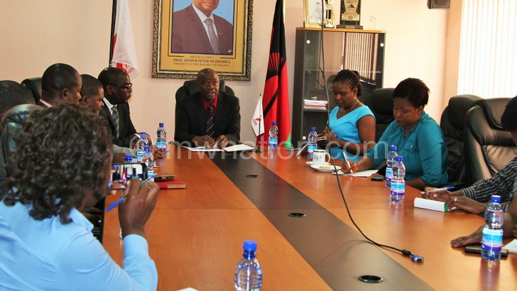 Itaye (facing the camera) stressing a point during the news conference yesterday