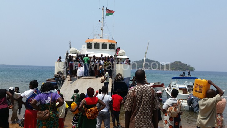 People from Likoma boarding a  boat to the mainland